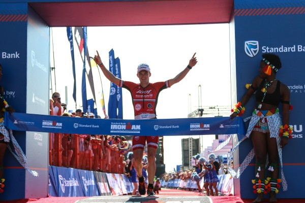"""""""PORT ELIZABETH, SOUTH AFRICA - APRIL 10: In this handout image provided by Ironman Ben Hoffman wins the men's event during the Standard Bank IRONMAN African Championship at Nelson Mandela Bay, Port Elizabeth on April 10th, 2016 in Port Elizabeth, South Africa. (Photo by Craig Muller/IRONMAN via Getty Images)"""""""