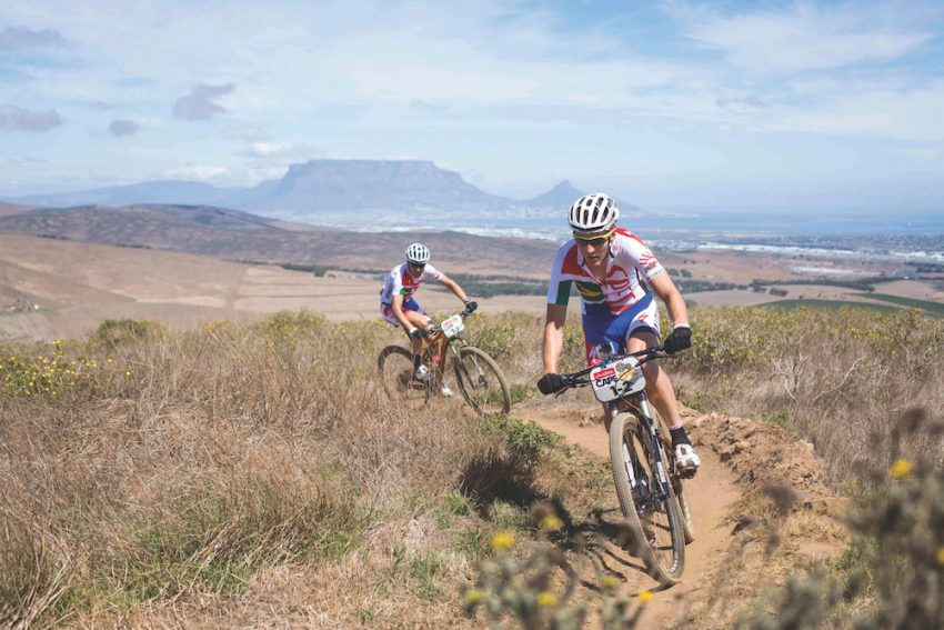 Jaroslav Kulharvy(Czech Republic) and Christoph Sauser(Switzerland) of Burry Stander-Songo take the stage win during the Prologue of the 2013 Absa Cape Epic Mountain Bike stage race held at Meerendal Wine Estate in Durbanville outside Cape Town, South Africa on the 17 March 2013..Photo by Nick Muzik/Cape Epic/SPORTZPICS